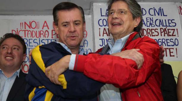 Guillermo Lasso y Andrés Páez